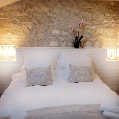 Bedroom with stone wall